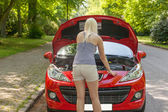 A young girl with a red car — Stock Photo