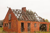 A little collapsed red house — Stock Photo