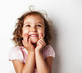 Happy little girl in studio — Stockfoto