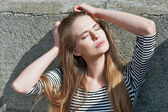Pretty girl whith long hair closed eyes — Stock Photo