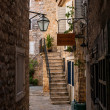 Old city in mounteins near water — Stock Photo