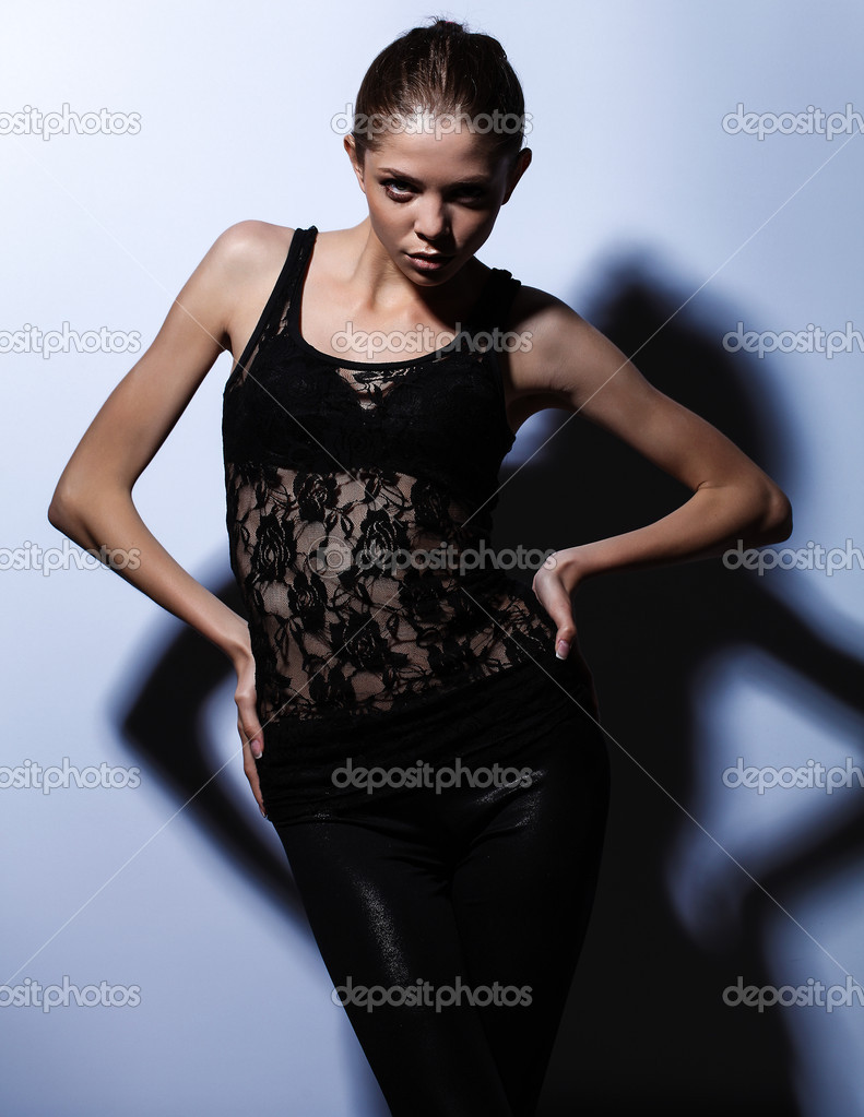 Women in black dress posing for camera — Stock Photo #12048594