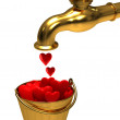 Royalty-Free Stock Photo: A bucket with hearts from the tap
