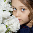 Beautiful girl with white flowers — Stock Photo