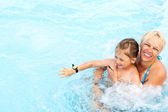 Woman and little girl swimming — Stock Photo