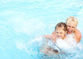 Woman and girl swimming in the pool — Stock Photo