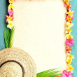 Lady's straw hat with plumeria — Stock Photo