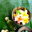 Plumeria with spa supplies on banana leaf — Stock Photo