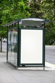 Bus stop with a blank billboard — Photo