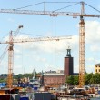 Construction crane in Stockholm - Stock Photo
