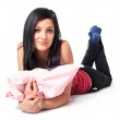 Attractive young brunette posing with pillow in her hands — Stock Photo #10760773