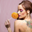 Candy, tattoo and lollipop — Stock Photo #10959392