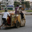 Pulling a Wooden Cart, Cambodia - Stock Photo