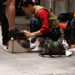 Shoe Shiner - Hong Kong City, Asia - Stock Photo