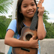 Stock Photo: Young GirlPlaying Guitar, Philippines