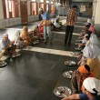 Stock Photo: Indians Eating On Floor at Golden Temple