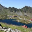 Balea glacial lake and road Transfagarasan, Romania — Stock Photo