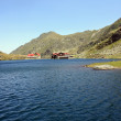 Balea Lake and chalet with the same name, situated on the top of the transfagarasan road — Stock Photo