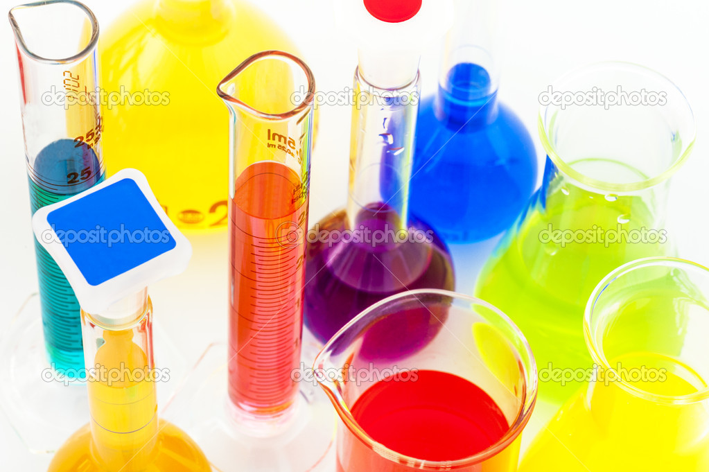 Chemical flasks with color liquids isolated on white background — Stock Photo #11800906
