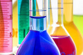 Laboratory glassware with liquids — Stockfoto