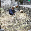 Nepalese willow man at work — Stock Photo