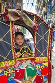 Portrait of boy in rickshaw — Stock Photo