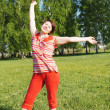 Woman rejoices to good weather — Stock Photo