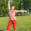 Stock Photo: Woman rejoices to good weather