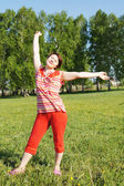 Woman rejoices to good weather — Stock Photo