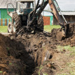 Backhoe is digging ditch — Stock Photo #10905548
