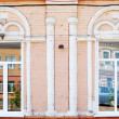 Stock Photo: Element of Old Russiarchitecture of end of nineteenth century. Design of windows in stone building.