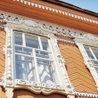 Stock Photo: Element of Old Russiarchitecture of end of nineteenth century. Window decoration.