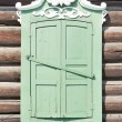 Stock Photo: Element of Old Russiarchitecture of end of nineteenth century. Window with closed shutters.