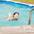 Woman is swimming in a pool — Stock Photo