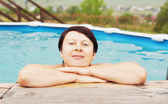 Woman in an outdoor pool — Stock Photo