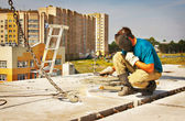 Welder works on the building of a house — Stock Photo
