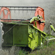 Stock Photo: Combine harvesting crops