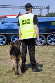 Railway station security guard officer with a dog — Stock Photo