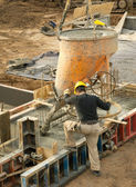 Construction worker pouring concrete — Stock Photo