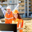 Female and male construction workers — Foto Stock