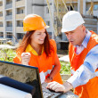 Female and male construction workers — Stock Photo