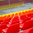 Royalty-Free Stock Photo: Close up of rows of red orange and yellow stadium chairs