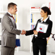 Business handshaking in the office — Stock Photo #10763140