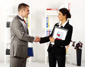 Business handshaking in the office — Stock Photo