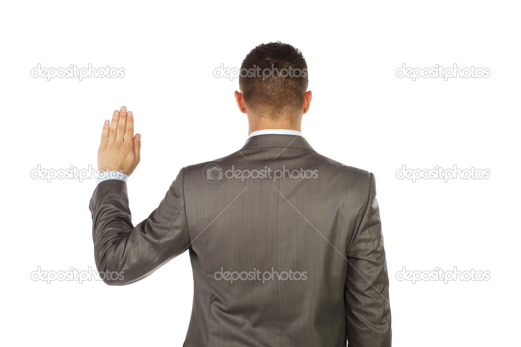 Young business man standing and making an oath with his back toward us  Stock Photo #10763167