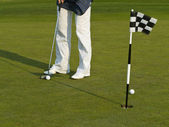 Golf training with ball and flag — Stock Photo