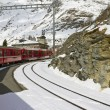 Red train at  Alp Grüm station — Stock Photo