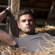 Man on hay — Stock Photo #11942355
