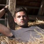 Man on hay — Stock Photo