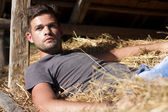 Man on hay — Stock Photo